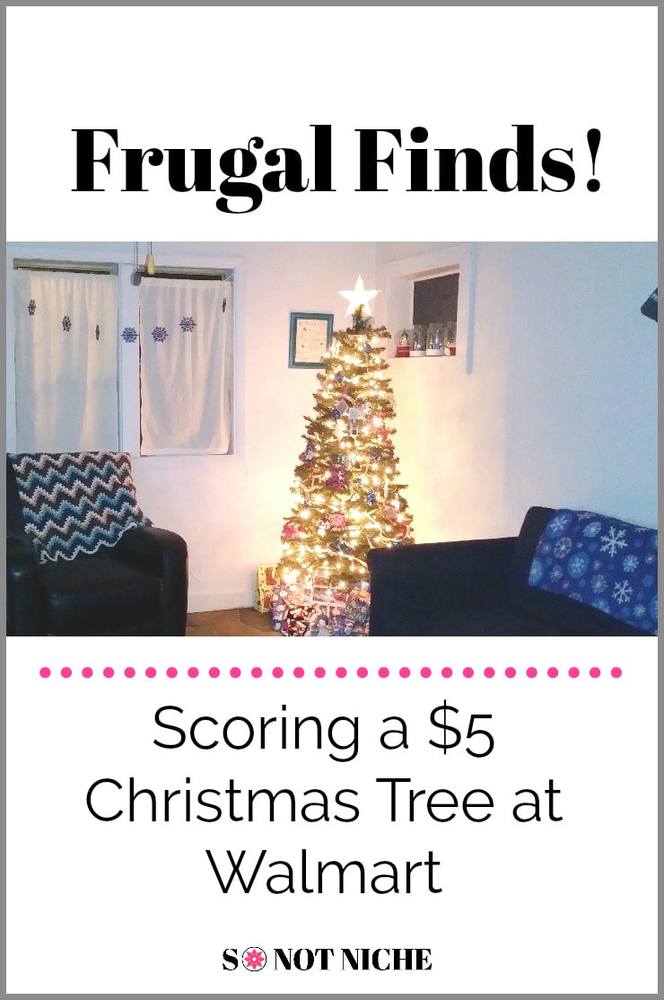 We lucked in to a budget-friendly Christmas tree at Walmart, and it's just perfect for our space.